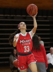 Former Arlington High School basketball standout Camille Loussedes is now playing for the Marist Red Foxes, as she practices with the team Oct. 9, 2019.