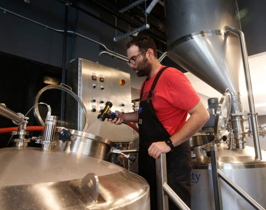 Zeus Brewing Company brewmaster Amit Ram washes one of the kettles in the brewery in the City of Poughkeepsie on October 8, 2019.