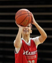 Former Arlington High School basketball standout Camille Loussedes is now shooting baskets for the Marist Red Foxes, as she practices with the team Oct. 9, 2019.