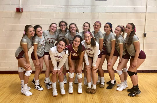 The Arlington volleyball team poses for a photo after its home win over Our Lady of Lourdes on Tuesday.