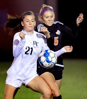 Dallastown's Delaney Davis, left, and Central York's Britlyn Higgins battle for possession during soccer action at Central Tuesday, Oct. 8, 2019. Bill Kalina photo