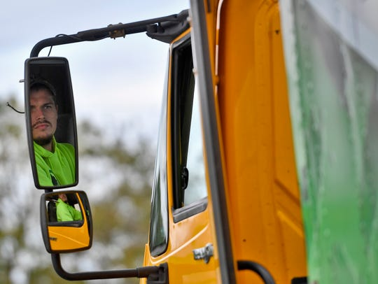 CDL student Zach Coombs of East Berlin uses his side mirrors while practicing backing into a loading dock, at the driver training facility in East Manchester Township, Wednesday, October 9, 2019. A new grant will allow York County School of Technology to provide free commercial driver training to veterans. John A. Pavoncello photo