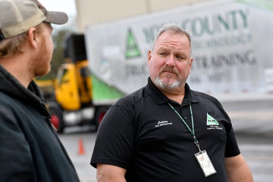 CDL instructor Calvin Wiley talks with students at the driver training facility in East Manchester Township, Wednesday, October 9, 2019. A new grant will allow York County School of Technology to provide free commercial driver training to veterans. John A. Pavoncello photo
