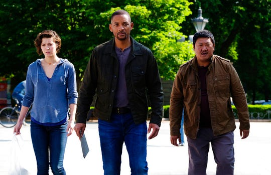 """From left, Mary Elizabeth Winstead, Will Smith and Benedict Wong star in """"Gemini Man."""" The movie is playing at Regal West Manchester, Frank Theatres Queensgate Stadium 13 and R/C Hanover Movies."""
