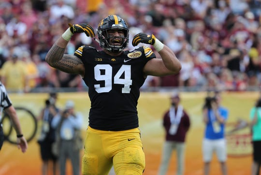 Jan 1, 2019; Tampa, FL, USA; Iowa Hawkeyes defensive end A.J. Epenesa (94) reacts after a force to fumble the ball against the Mississippi State Bulldogs during the second quarter in the 2019 Outback Bowl at Raymond James Stadium. Mandatory Credit: Kim Klement-USA TODAY Sports
