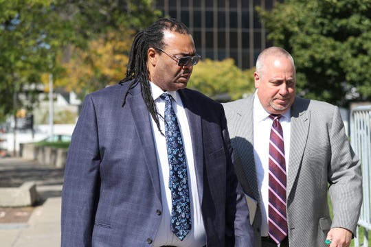 Adam McFadden  arrives at  Federal Court with his attorney Joseph Damelio before  pleading guilty to felony wire fraud  for submitting more than $131,000 in false invoices while he was director of Quad A for Kids.