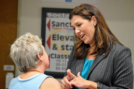 Megan Dahle (right) speaks with an audience member after an Oct. 8 candidate forum in Redding. Dahle is running to represent California's 1st Assembly District in a 2019 special election.
