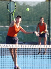 San Angelo Central's Halle Jost hits a volley as doubles partner Olivia Henderson looks on during the District 3-6A championship against Abilene High in San Angelo on Tuesday, Oct. 8, 2019. Abilene defended its district title with a 12-7 victory.