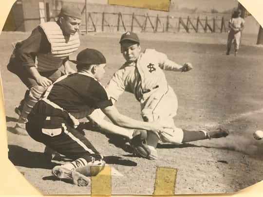 A San Angelo runner slides to beat the tag in this undated file photo.