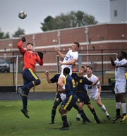 Pocomoke goalie Ethan Peterson goes for the save against Stephen Decatur on Tuesday, Oct. 8, 2019.