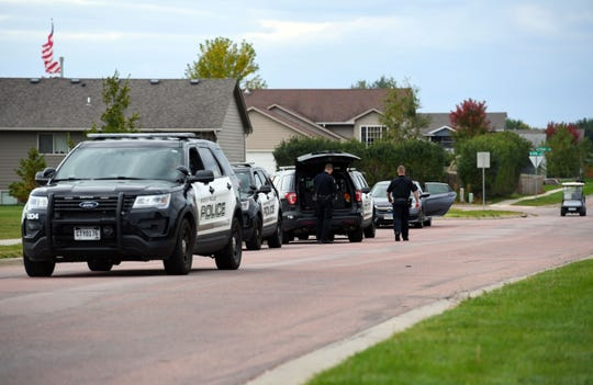 Police cars line the park in the Northern Heights neighborhood as officers gather equipment to conduct a search on Wednesday, Oct. 9, in Sioux Falls.