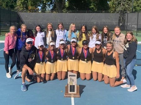The Desert Hills tennis team poses after winning the 4A State Championship.