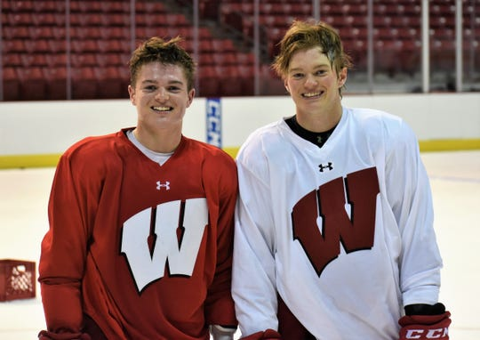 Brothers Cole Caufield, left, and Brock Caufield from Stevens Point are teammates again on the University of Wisconsin hockey team.