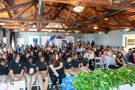 AmeriCorps volunteers and guests fill Flagler Place in Stuart for Martin County Boys & Girls Clubs' AmeriCorps Opening Day on Oct. 4, 2019.