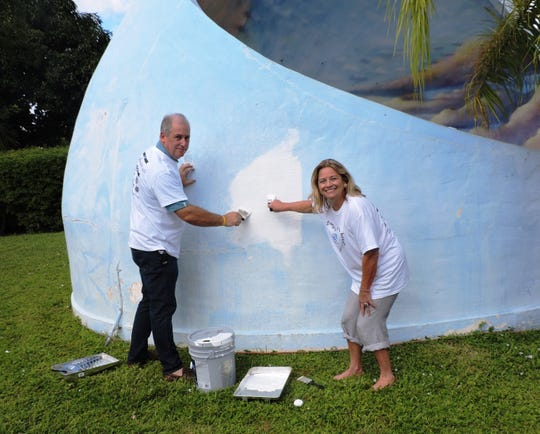 Martin County Commissioner Ed Ciampi, left, and Stuart Mayor Becky Bruner take part in the AmeriCorps Opening Day beautification project at Memorial Park on Oct. 4, 2019.