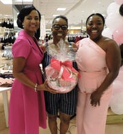 "Arnater Dowers, left, Relaxation Basket winner Ramona Anderson and Yatcha Barnes at Alpha Kappa Alpha Sorority, Psi Pi Omega Chapter's ""Fashionably Pink"" event at Dillard's at Treasure Coast Square mall on Oct. 5, 2019."