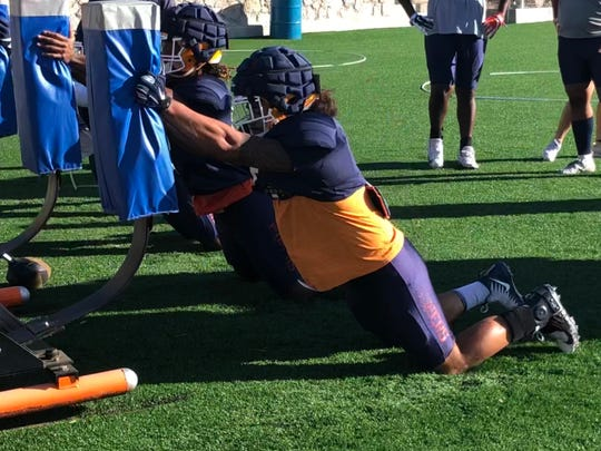 Sione Tupou competes in a drill Wednesday at UTEP's football practice at Glory Field
