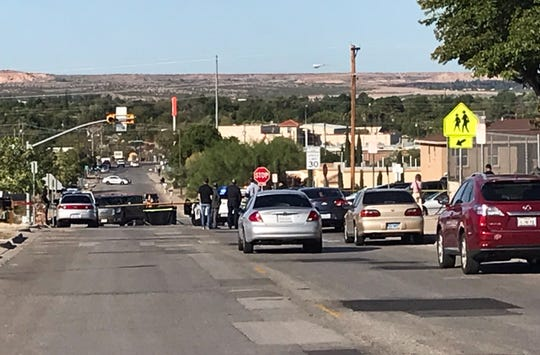 El Paso Police Department Special Traffic Investigation Unit investigators work the scene near Oran Roberts Elementary School, 341 Thorn Ave., where a 7-year-old girl in a crosswalk was fatally struck Wednesday morning, Oct. 9, 2019.