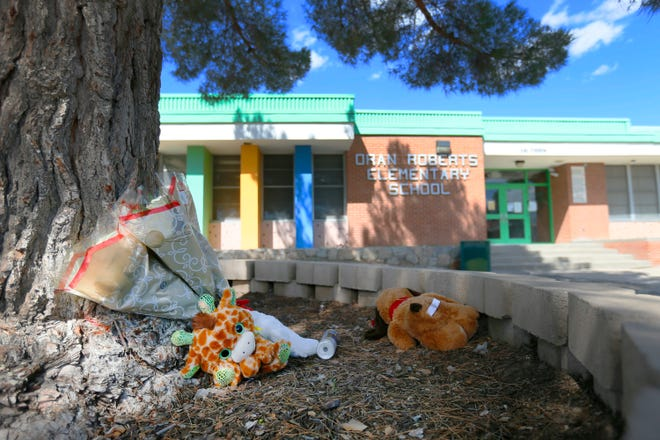 Flowers and stuffed animals are placed outside Oran Roberts Elementary School on Wednesday, Oct. 9, 2019, in memory of 7-year-old first-grader Alexa Barrera, who was fatally struck by an SUV Wednesday morning while walking to school.