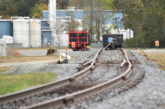 Railroad cars will carry away hazardous metal manufacturing byproducts from the long-closed Shieldalloy Metallurgical Corporation plant in Newfield, pictured here on Wednesday, Oct. 9, 2019.