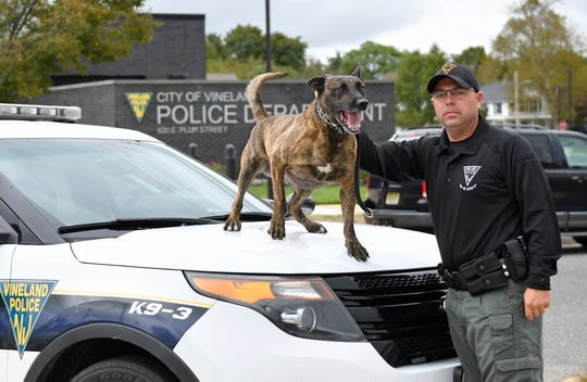 Vineland Police Officer Robert Magee poses for a photo with his K-9 partner Dirk on Wednesday, October 9, 2019.