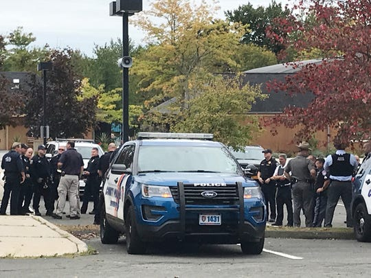 Police from several Westchester agencies stage in a lot near the EF Academy on Columbus Avenue in Thornwood after a threat at the school Oct. 8, 2019.