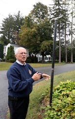 Village Manager Philip Zegarelli discusses the stolen sign at the intersection of Larch and Maple Roads in Briarcliff Manor Oct. 9, 2019. A string of 21 signs have recently been stolen in the village.