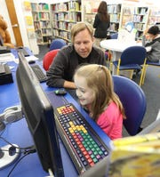 Dino Doremus and his daughter, Ella, in the children's room of the West Nyack Free Library Oct. 9, 2019.