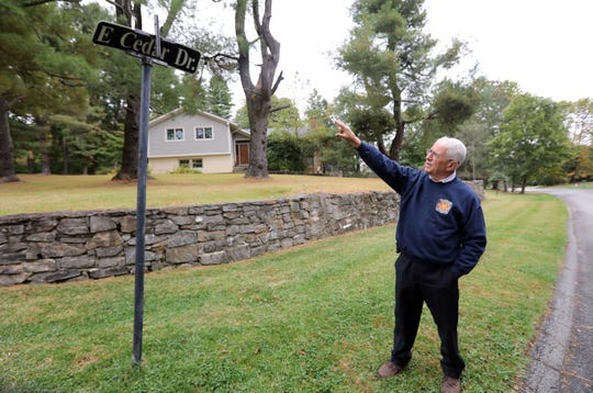 Village Manager Philip Zegarelli talks about the vandalized sign at the intersection of East Cedar Drive and Frame Road in Briarcliff Manor Oct. 9, 2019. The Frame Road portion of the sign was stolen. A string of 21 signs have recently been stolen in the village.