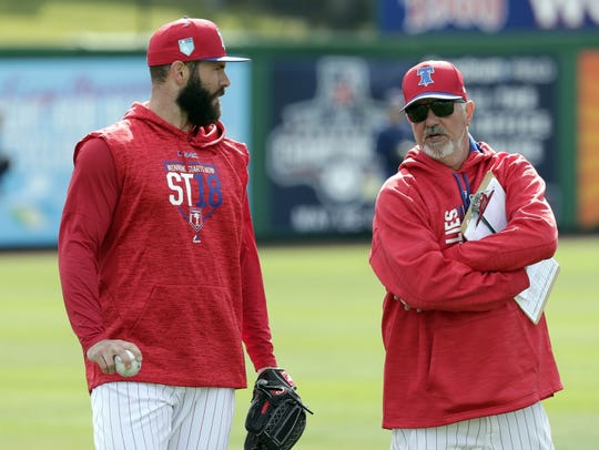 Phillies pitcher Jake Arrieta, left, talks with then-pitching coach Rick Kranitz during a workout before an exhibition game against the Tampa Bay Rays in March of 2018 in Clearwater.