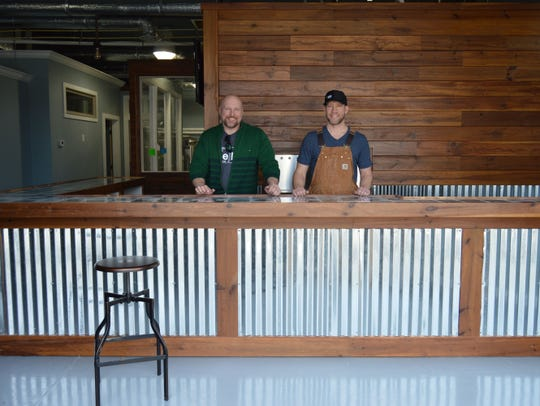 Harry Metcalfe, left, and Patrick Staggs of Revelation Brewing Company, stand behind their microbrewery bar, located in West Rehoboth, on March 23, 2016.