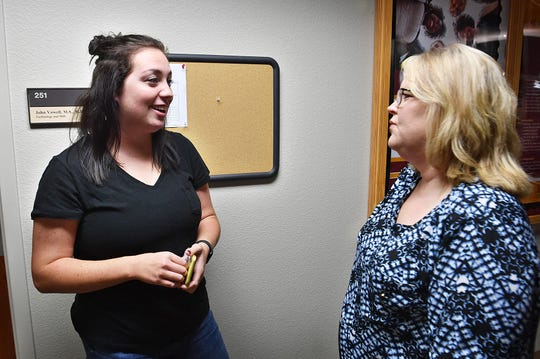 Midwestern State University Mass Comm student Sarah Graves, left, talks with Johnna Lynn Weigand about a recent study abroad trip. Weigand is the Study Abroad Specialist in the Global Education Office at MSU Texas.