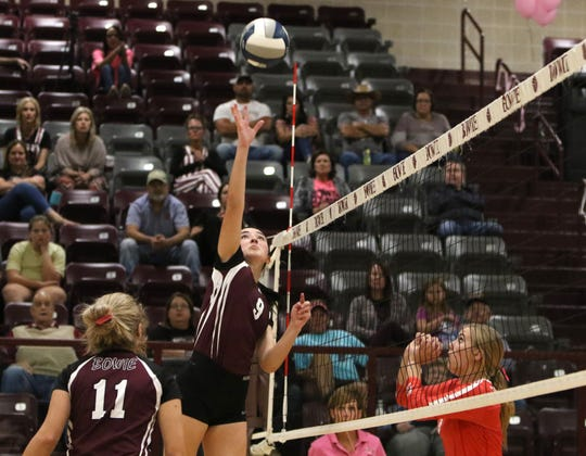 Bowie's Aslyn Davis hits the ball in the match against Holliday Tuesday, Oct. 8, 2019, in Bowie. The Lady Rabbits defeated the Lady Eagles in straight sets 25-21, 25-21, 26-24.