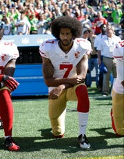 Colin Kaepernick takes a knee during the national anthem on Sept. 25, 2016.