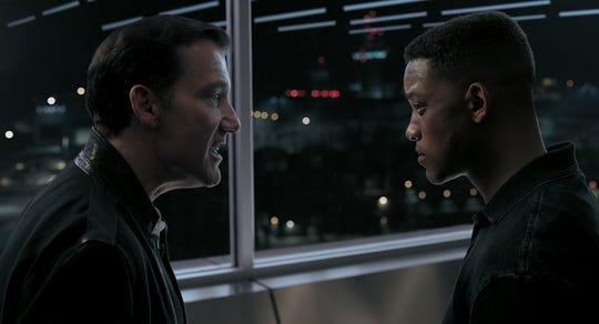 "Clay Verris (Clive Owen, left) has big plans for Junior (Will Smith) in ""Gemini Man."""
