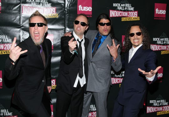 Metallica (from left, James Hetfield, Lars Ulrich, Robert Trujillo and Kirk Hammett) was inducted into the Rock and Roll Hall of Fame in Cleveland in 2009.