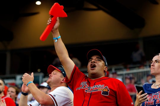 A Braves fan holds a foam tomahawk during Game 1 of the NLDS.