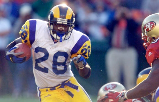 Marshall Faulk was a three-time NFL Offensive Player of the Year and is the only player in league history with 12,000 rushing and 6,000 receiving yards.