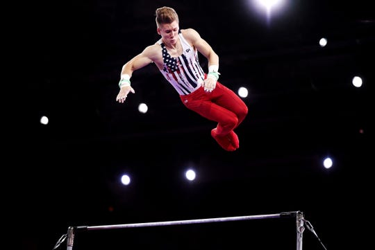 Shane Wiskus of the U.S. on the high bar during the men's team final at the world gymnastics championships.
