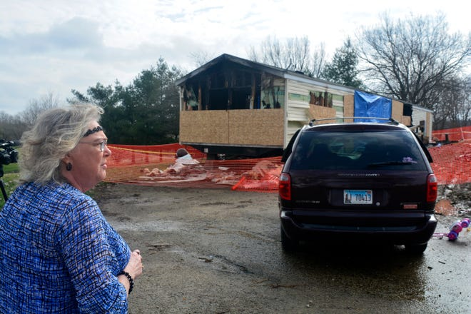 Marie Chockley, a resident of the Timberline Trailer Court, surveys the damage April 7, 2019, that was caused by a fire that killed five residents in a mobile home.