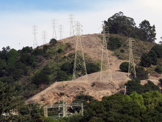 A view of power lines in the hills of Oakland, Oct. 8, 2019.