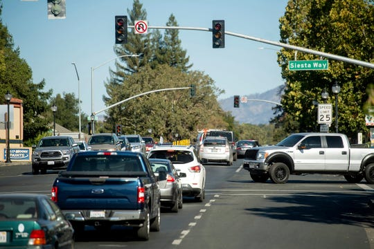 Vehicles back up on Highway 12 as traffic signals remain dark during a power outage on Oct. 9, 2019, in Boyes Hot Springs, Calif.