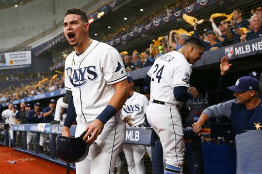 Game 4 – Willy Adames celebrates after the Rays scored a run in the first.