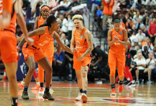 Connecticut Sun guard Natisha Hiedeman celebrates with teammates during a game earlier this season.