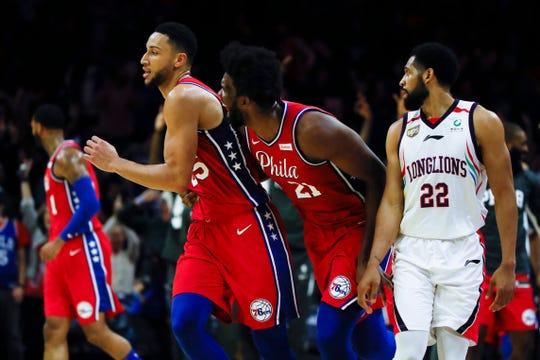 Philadelphia 76ers' Joel Embiid celebrates Ben Simmons' 3-pointer.