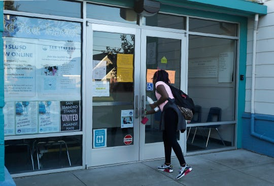 Garfield Elementary School student Terreece Douresseau attempts to enter the front door of the school only to learn the school has been closed due to a possible power outage by Pacific Gas & Electric on Oct. 9, 2019, in San Leandro, Calif.