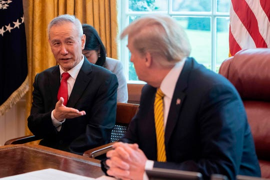 In this file photo taken on April 4, 2019 China's Vice Premier Liu He (L) speaks with US President Donald Trump during a trade meeting in the Oval Office at the White House in Washington, DC.