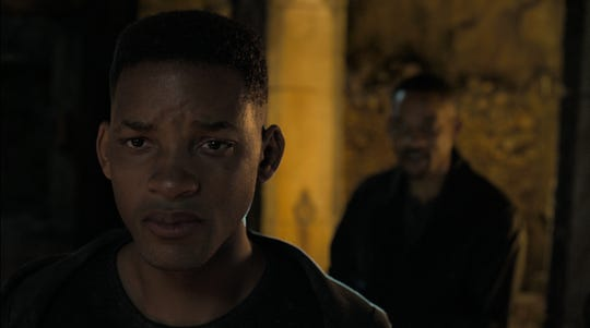 """Junior (Will Smith, left) comes to grips with the fact that he's a clone of Henry Brogan (also Smith) in """"Gemini Man."""""""