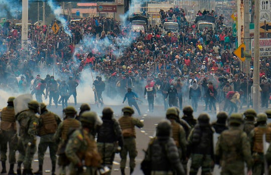 Demonstrators clash with riot police in Quito, Ecuador on Oct. 7, 2019.
