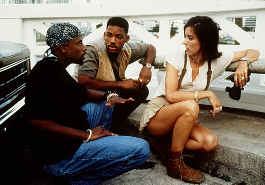 "Martin Lawrence (left) and Will Smith keep Tea Leoni safe from a drug kingpin in ""Bad Boys."""